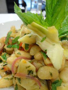 Fagioli Bianco with fresh herbs, marinated artichokes hearts, pickled sicilian eggplants, with fresh lemon juice and extra olive oil