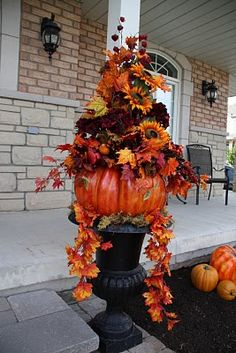 I will make this with a shorter pot, same style from Home Depot for $5 then spray paint it black then add fake cheap fall leaf garland from the Dollar Tree along with cheap plastic pumpkins..oh yes, I will make this! Halloween Door Decorations, Thanksgiving Decorations, Scary Mask, Gnome Garden, Gnomes, Creepy, Thanksgiving Door Decorations