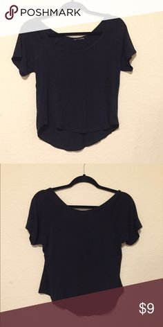 Cute black brandy melville top Cute brandy melville top, slightly cropped- I wouldn't call it a crop top but it's not a long shirt. Super soft and comfy, worn maybe twice Brandy Melville Tops Tees - Short Sleeve