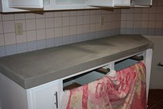 Quick Install Concrete counter tops over existing counters featured on Remodelaholic.com #concrete #counters