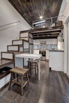 Clean, modern design in this 304 sq.ft. tiny house.  Includes a large kitchen, storage stairs, and a living room with pull-out couch.