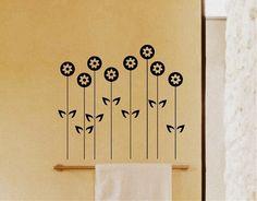 Vinilo con una composición floral de corte minimalista pensado para ofrecer el complemento decorativo perfecto en cualquier tipo de ambiente sin recargarlo ni dejar que el motivo sea un único protagonista.