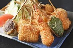 Kushikatsu is a kind of Katsu where ingredients are pierced in wood sticks. Osaka is famous for Kushikatsu. This food can be found in street stalls as well.