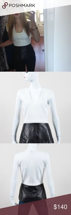 Daniel Vosovic Stretch Knit Leather Peplum White stretch knit bodice with black leather peplum panel. Sleeveless. Squared v-neckline. Back zipper with hook & eye closure. Lined.   Fabric Content: Bodice: 49% Modal, 27% Nylon, 21% Cupra, 3% Polyurethane; Trim: 100% Leather Fabric Care: Dry Clean Only  Great condition Daniel Vosovic Tops Blouses
