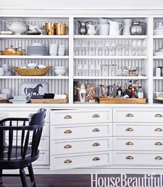 Inspired by a vintage printer's desk, Monica Bhargava had the cabinets in her California kitchen made to look like drawers.   - HouseBeautiful.com