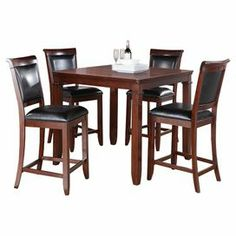 """Perfect for weekend breakfasts and farm-fresh dinners, this counter-height dining set features faux leather-upholstered chairs and chamfered detailing.   Product: 4 Chairs and 1 tableConstruction Material: Rubber wood, cherry veneers, engineered wood and faux leatherColor: Medium brown cherry and blackDimensions: 36"""" H x 42"""" W x 42"""" D (table)"""
