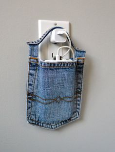 Cell phone docking station made with a  pair of Jeans that no longer fit me or a family member or a pair that were damaged &/or no longer wearable.