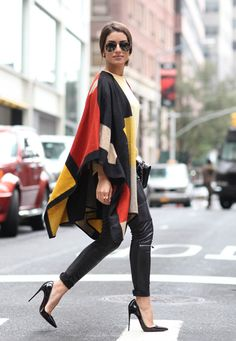 Shop this look on Lookastic: https://ca.lookastic.com/women/looks/poncho-crew-neck-t-shirt-skinny-pants/14606   — Yellow Crew-neck T-shirt  — Multi colored Poncho  — Black Quilted Leather Satchel Bag  — Black Leather Skinny Pants  — Black Leather Pumps  — Black Sunglasses