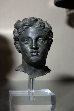 Bronze bust of Hermes (Turms) or Perseus (Ferse), the eyes inlaid with silver, Etruscan, 150-50 BC.  Held in the British Museum.