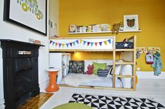 My sons bedroom with yellow wall