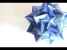 Really neat looking ball, maybe when I feel extremely patient I'll give it a try! Origami ball / Kusudama Paradigma (Ekaterina Lukasheva)