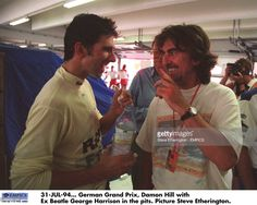 Damon Hill with Ex-Beatle George Harrison in the pits.