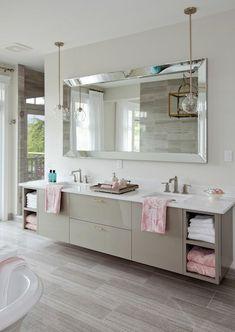 floating vanity, tile floor, mirror & pendants