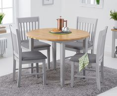 The Genoa Oak and Grey Extending Table with Chairs with Fabric Seats is designed to seat 4 people and features a hardwood drop leaf dining table and matching chairs with fabric seat pads. Space Saving Dining Table, Grey Dining Tables, Glass Dining Table, Extendable Dining Table, Fabric Dining Chairs, Chair Fabric, New Furniture, Outdoor Furniture Sets, Oak Furniture Superstore