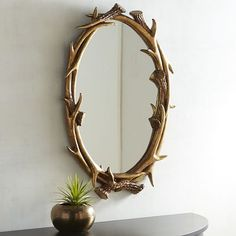 Rustic yet refined, our antler mirror is a study in primitive beauty that brings the outdoors in while adding a golden touch to the wall it graces.