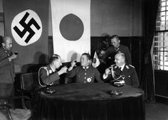The Tripartite Pact is signed. Adolf Hitler shakes hands with ...