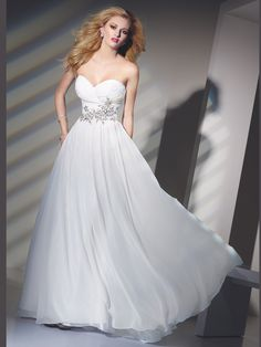 Feel like a celebrity when you go to your elite parties in this classic elegant 2012 Alyce Designs 6705 prom dress. The top of the bust is ruched until the natural waist with a sweetheart neckline. The waist is beaded jewel just enough to give your look some sparkle. For a clean finish in the skirt the chiffon is layer for a ball gown. Order it in white for a wedding reception dress or rehearsal gown.