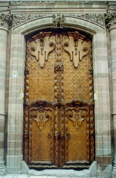 ♅ Detailed Doors to Drool Over ♅  art photographs of door knockers, hardware & portals - Hand carved door, once the Canal Family Home.