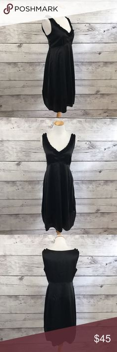 "Tahari Black Silk Empire Waist A-Line Dress Simple chic black silk dress with a ruffle trim v-neckline, empire waistline and an a-line silhouette. Perfect for any ""little black dress"" occasion. Measurements: Chest (18.25"") Waist (16"") Length (39"") T Tahari Dresses"