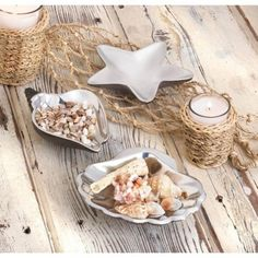 SEA CONCH DECORATIVE DISH It's high tide for high style with this beautiful sea conch decorative dish. Finished in gleaming silver, it will add a splash of seaside glamour to your home.  Materials: METAL