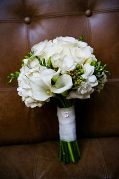 bridal bouquet hand held roses freesia calla lily white flowers