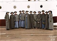Twelve nurses from Victoria pose beside the hospital ship A61 HMAT 'Kanowna' at Port Melbourne, Melbourne. 6 July 1916. (Source: Australian War Memorial - PB0482 - Photographer, Josiah Barnes) (Colorised by Jean-Marie Gillet from France)