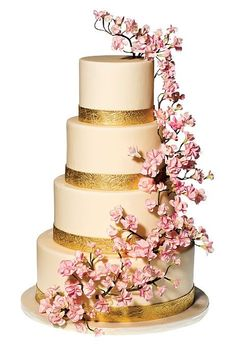 Brides.com: . Ana Parzych Cakes, New York, NY. Cherry blossoms are wildly popular for spring weddings, and these hand-wired gum-paste blooms are beautiful with the gold trim.  Cream-colored wedding cake with gum-paste flowers and gold bands, $15 per slice (serves 200), Ana Parzych Cakes  See more cakes for a spring wedding.