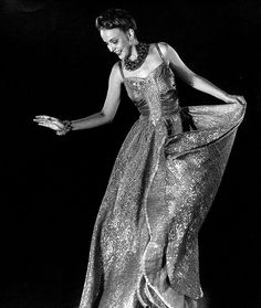 A model sporting an enchantingly lovely gold brocade evening dress, 1938. #vintage #1930s #fashion #dress