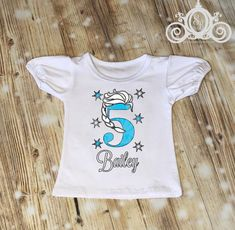 """This listing is for the specific design shown. If you are looking for custom designs, please choose the blank """"Custom Design"""" shirt in the color of your choice. Please add a photo or comment in the box at checkout to let us know what design you would like on your shirt. We have a great selection of tops for your little princess. We are very well known for ruffle raglans in a rainbow of colors. But during the super hot months, we need something a little cooler but still really cute and girly… Frozen Birthday Shirt, Elsa Birthday, Birthday Shirts, Elsa Braid, Pumpkin Outfit, Custom Design Shirts, True True, Basic Tees, Design Show"""