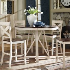 Perfect for a small or moderate sized area, the Ellinger dining table offers country style which will completely transform your nook or kitchen space. This table is versatile yet pleasing to the eye, creating the ideal gathering place.