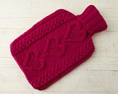 Knitted Hot water Bottle Cover in Merino Wool Hearts Pink Aran Cable.