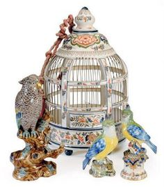 A CONTINENTAL FAIENCE BIRD CAGE AND AN AVIARY OF THREE BIRDS,  19TH/20TH CENTURY,