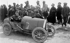 Early racing driver Raymond Mays attracts the attention of locals in his Bugatti Brescia at Porthcawl on June 29, 1922