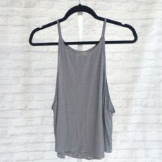Striped Low Cut Tank Perfect for summer! Layer and show off a super cute bralette with this low side cut. From Aussie shop - SHOWPO Showpo Tops Tank Tops