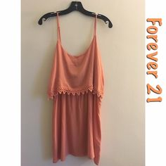 Peach mini dress Forever 21 Peach short dress. Size: Large. It is a short dress but can be worn as a longer tank. It has an elastic waistband across the middle. Color: Peach. 100% Rayon. Note: It is new with tags, i purchased it and realized it wasn't my style. Retailed for $15.80, but I'm selling for $12. Forever 21 Dresses Mini