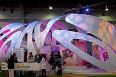Seven organic tension fabric shapes created this unique 57ft x 20ft tradeshow environment.