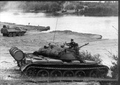 Polish T-55 main battle tank and SKOT armored transporter during excercises on proving ground