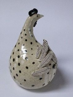 Ceramic hens and ceramic chickens by artist and potter Jane Silk. Ceramic Guinea fowl, winter birds, runner ducks, penguins and cormorants.