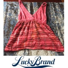 Lucky Brand Tank Tie Dye Top with Metallic Stripes Lucky Brand Tank Tie Dye Top with Metallic Stripe Pattern bottom. Front and back V neckline. Length is 24 in. Braided waist elastic is 12 in. 17 in bust. Red with black, pink & orange. Lucky Brand Tops Tank Tops