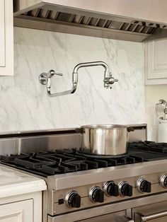 Installing a stunning backsplash to make a big impact in your kitchen! Get our tips for materials, terms, and trends: http://www.bhg.com/kitchen/backsplash/tile-kitchen-backsplash