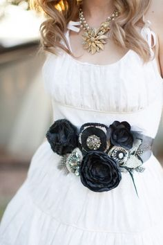 The cutest belt for an alternative wedding dress ever! This black flower belt not only cinches and defines her waste, but it really gives a cute alternative to all white dresses.