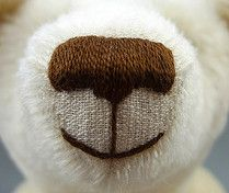 Фото 26. Нос и рот мишки вышиты, сделаны выдерг и выстриг мордочки мишки. На фото - результат нашей работы.