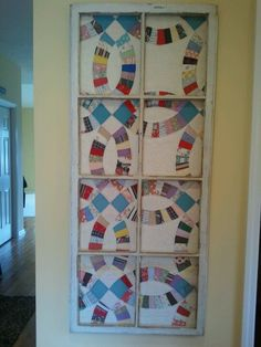 Love this quilt framed with an old window.  It's a great way to display an old quilt that may be falling apart and no longer useable.