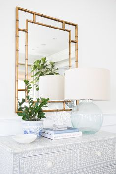 Brass mirror, Chinese fishbowl planter, bone inlay dresser. But different colors, esp walls and dresser. Not as pale, white, washed out looking. Studio McGee