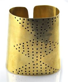 """Diamond Brass Cuff $85.00  These stunning brass cuffs feature a geometric diamond pattern. Handmade in Kenya from recycled brass. Slightly malleable for an adjustable fit. Width is 3"""".  Sold individually but designed to be worn as a pair."""