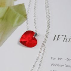 A perfect gift for Valentine, a red Swarovski Crystal heart pendant, matched with sterling silver cable chain and components.  The pendant is made of the 2014 LEAD FREE Swarovski Crystal.