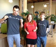 The good folks at Mutually Human are excited about their new T-Shirts. I wonder what song that guy in the background is playing?