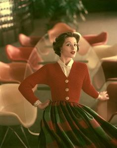 Full plaid skirt, with red cardigan which has gold buttons, and a white blouse, by Greta Plattry, 1956   by skorver1