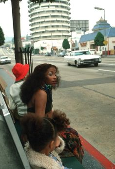 Chaka Khan waiting at the bus stop in Hollywood near Capitol Records building.