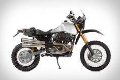 If you own a Harley Davidson 1200 or 883 Sportster made between 1993 and 2003, the guys at Carducci want to help turn it into an SC3 Adventure Dual Sport Motorcycle. You supply the bike, they supply everything else, including the swing arm, gas tank, foot controls, fly screen, crash bar, skid plate, subframe, and more — doing all the assembly in their California shop. When you get your bike back, it'll be a fully-street-legal, off-road machine.